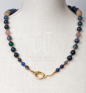 The Snail with Lapis Nuggets and Bamboo Coral