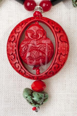 Buddha in Carved Cinnabar by Christina Jarmolinski